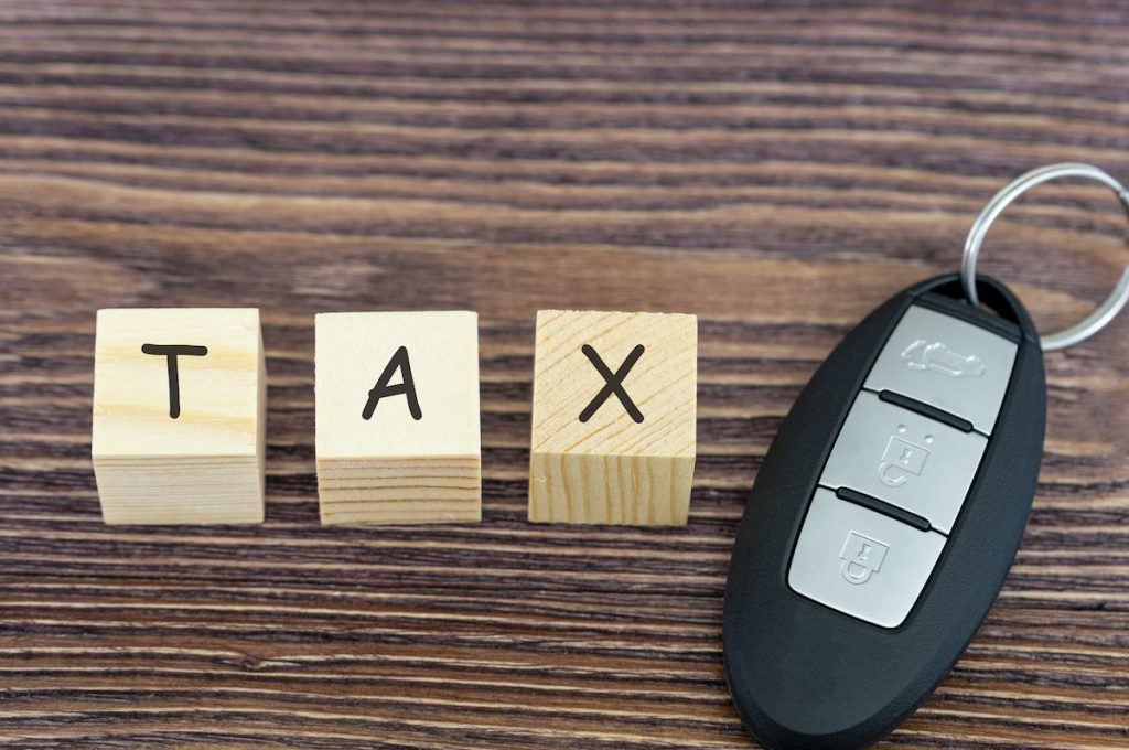 tax on cars, the inscription on wooden cubes and the key to the car