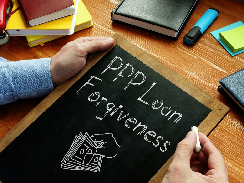 PPP Loan Forgiveness is shown on the conceptual business photo